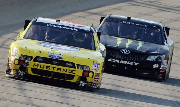 Ricky Stenhouse Jr., (6) leads Kyle Busch (54) during the NASCAR Nationwide Series auto race at Chicagoland Speedway in Joliet, Ill., Saturday, Sept. 15, 2012. (AP Photo/Warren Wimmer)