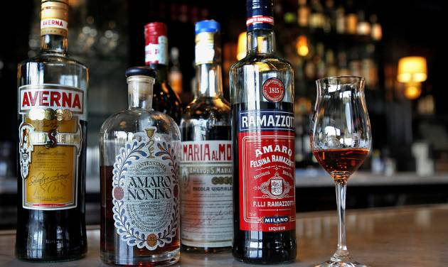 A selection of Italian bitters, including Amaro Nonino in the glass, is displayed at Osteria Mozza in Los Angeles, California. (Katie Falkenberg/Los Angeles Times/MCT)