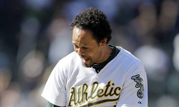 Oakland Athletics' Coco Crisp is lifted by teammate Josh Reddick after driving in the winning run in the 12th inning of their baseball game against the New York Yankees, Sunday, July 22, 2012, in Oakland, Calif. Oakland won the game 5-4 to sweep their four-game series. (AP Photo/Eric Risberg)