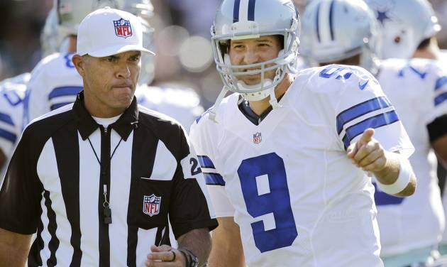 Dallas Cowboys quarterback Tony Romo (9) talks with an official during the first quarter of an NFL preseason football game against the Oakland Raiders in Oakland, Calif., Monday, Aug. 13, 2012. (AP Photo/Ben Margot) ORG XMIT: OAS108