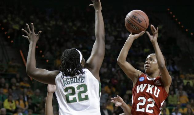 Baylor's Sune Agbuke, left, defends against a shot by Western Kentucky's Bianca McGee during the first half of a first-round game in the NCAA women's college basketball tournament, Saturday, March 22, 2014, in Waco, Texas. (AP Photo/Tony Gutierrez)