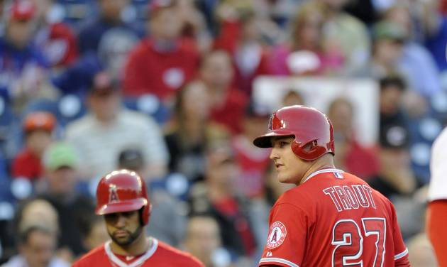 Los Angeles Angels center fielder Mike Trout (27) looks back after he struck out during the first inning of a baseball game against the Washington Nationals, Monday, April 21, 2014, in Washington. Also seen is Albert Pujols (5). (AP Photo/Nick Wass)