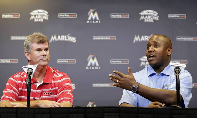 FILE - In this Sept. 29, 2013, file photo, Miami Marlins' Michael Hill, right, talks to the media at a news conference after being promoted to president of baseball operations as new general manager Dan Jennings, left, sits near in Miami. Hill and Jennings started working together in 1995, and early 20 years later, limited resources remain a challenge, with Hill and Jennings now running the Marlins for owner Jeffrey Loria. (AP Photo/Alan Diaz, File)