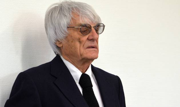 "Formula One boss Bernie Ecclestone waits in the court in Munich , southern Germany,  Tuesday, July 1, 2014. Ecclestone is charged with bribery and incitement to breach of trust ""in an especially grave case"" over a US $44 million payment to a German banker, that prosecutors allege was meant to facilitate the sale of the Formula One Group to a buyer of Ecclestone's liking. (AP Photo/Kerstin Joensson,Pool)"
