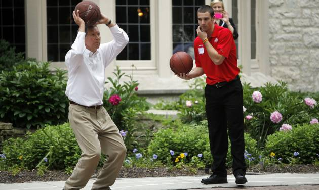 In a Tuesday, May 15, 2012 photo, Ohio Governor John Kasich, left, takes a shot as OSU's Aaron Craft waits his turn in a game of Horse at the Governor's residence in Bexley, Ohio. A reception recognizing Ohio's NCAA Tourney Sweet 16 teams was held at the house. (AP Photo/Columbus Dispatch, Shari Lewis)