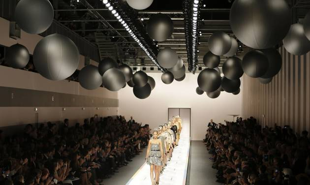 Models wear creations part of the Fendi women's Spring-Summer 2013 fashion collection, during the fashion week in Milan, Italy, Saturday, Sept. 22, 2012. (AP Photo/Antonio Calanni)
