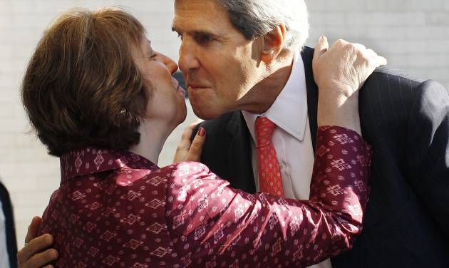 U.S. Secretary of State John Kerry, right, greets European Union Foreign Policy Chief Catherine Ashton after arriving for an informal meeting of EU ministers for Foreign Affairs at the National Art Gallery in Vilnius, Lithuania, Saturday, Sept. 7, 2013. (AP Photo/Mindaugas Kulbis)