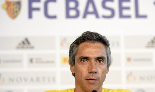 FILE-  In this July 29, 2013 file picture  Portugal's Paulo Sousa, then head coach of Israel's soccer team Maccabi Tel Aviv FC, speaks during a press conference in  in Basel, Switzerland. Swiss champion Basel has hired Paulo Sousa of Portugal as coach. Basel says Wednesday May 28, 2014  the two-time Champions League-winning player has signed a three-year contract. Sousa replaces Murat Yakin, who left this month amid reports of poor relations with players despite guiding the team to its fifth straight Swiss league title.  (AP Photo/Keystone,Georgios Kefalas,file)