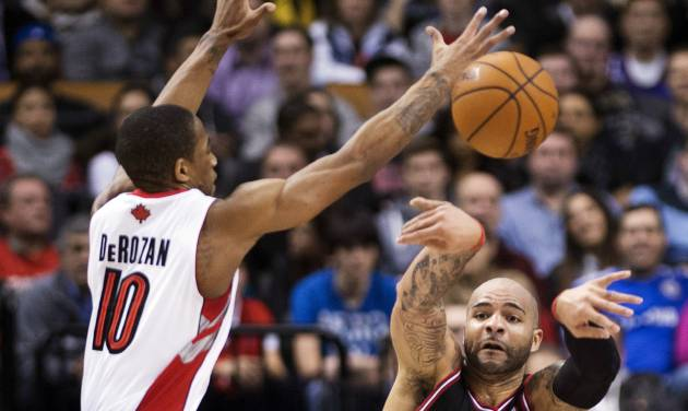 Toronto Raptors forward DeMar DeRozan (10) tries to block a pass from Chicago Bulls forward Carlos Boozer, right, during the first half of their NBA basketball game, Wednesday, Jan. 16, 2013, in Toronto. (AP Photo/The Canadian Press, Nathan Denette)