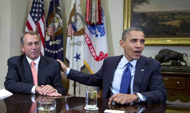 FILE -In this Friday, Nov. 16, 2012, file photo, President Barack Obama acknowledges House Speaker John Boehner of Ohio while speaking to reporters in the Roosevelt Room of the White House in Washington. U.S. stocks shook off their post-election slump Monday and recorded big gains as investors appeared more optimistic about a deal to avoid a federal budget crisis and were encouraged by a pair of corporate earnings reports. (AP Photo/Carolyn Kaster)