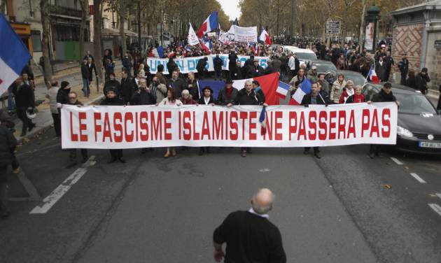 """People hold a banner reading: 'islamic fascism shall not pass"""" during a demonstration in Paris, Saturday Nov.10, 2012. France is home to Western Europe's largest population of Muslims, estimated to be at least 5 million even though the government does not provide official figures. Many have family roots in former French colonies in northern Africa. (AP Photo/Thibault Camus)"""