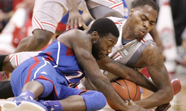 Ohio State's DeShaun Thomas (1),right, fights for loose ball with Kansas' Elijah Johnson, left, during the first half of an NCAA college basketball game Saturday, Dec. 22, 2012, in Columbus, Ohio. (AP Photo/Mike Munden)