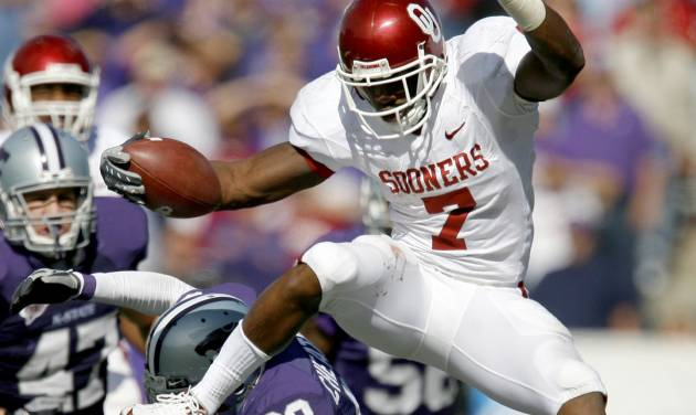 OU's DeMarco Murray leaps over Ray Cheatham of Kansas State during the college football game between the University of Oklahoma and Kansas State University in Manhattan, Kansas, Saturday, October 25, 2008.  BY BRYAN TERRY, THE OKLAHOMAN