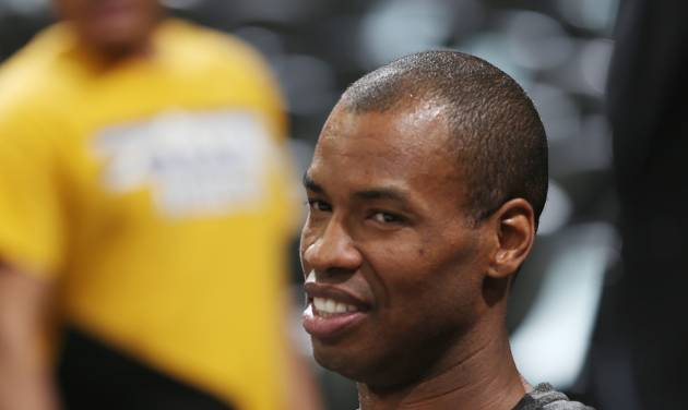 Brooklyn Nets center Jason Collins rests in a courtside seat after warming for the Nets' NBA basketball game against the Denver Nuggets in Denver on Thursday, Feb. 27, 2014. (AP Photo/David Zalubowski)