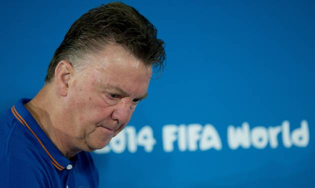 Netherlands head coach Louis van Gaal arrives for a news conference at the Estadio Nacional in Brasilia, Brazil, Friday, July 11, 2014. The Netherlands will face Brazil in the World Cup third-place match Saturday. (AP Photo/Andre Penner)
