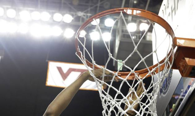 Notre Dame's Jewell Loyd (32) cuts the net after defeating Duke in the NCAA college basketball championship game of the Atlantic Coast Conference tournament in Greensboro, N.C., Sunday, March 9, 2014. Notre Dame won 69-53. (AP Photo/Chuck Burton)