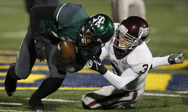 Memorial's Sam Kreutzer (3) takes down Santa Fe's Trevan Smith (2) during a high school football game between Edmond Memorial and Edmond Santa Fe at Wantland Stadium in Edmond, Okla., Friday, Oct. 26, 2012.  Photo by Garett Fisbeck, The Oklahoman