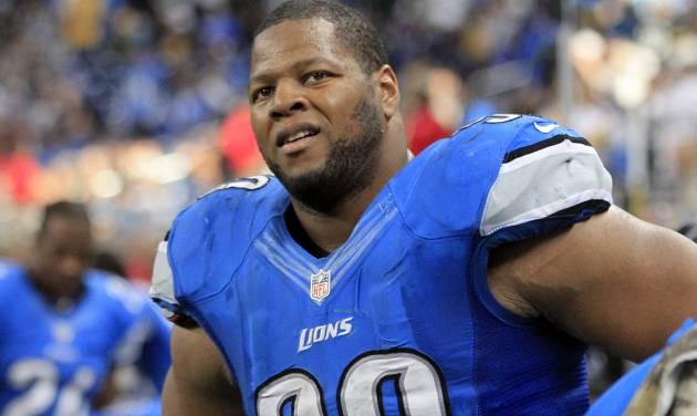 In this Nov. 18, 2012 photo, Detroit Lions defensive tackle Ndamukong Suh (90) watches from the bench during the fourth quarter of an NFL football game against the Green Bay Packers at Ford Field in Detroit. Suh was issued a traffic citation by a police officer who said he saw Suh driving fast and passing cars from the right lane of a suburban Detroit roadway. The Lathrup Village officer gave Suh a ticket on Nov. 15, 2012 for driving without due care and caution. (AP Photo/Carlos Osorio)