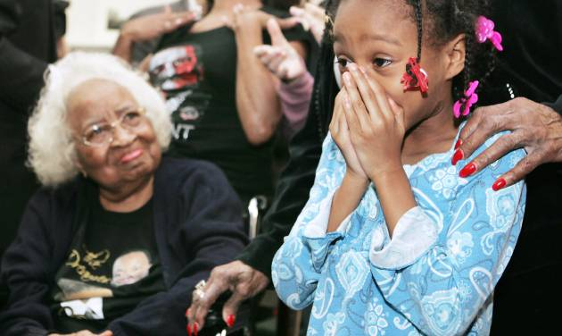 Civil rights leader Clara Luper, her daughter Marilyn Hildreth and 9-year-old Alexia Grant react Tuesday to the inauguration of President Barack Obama. Luper was watching the ceremony on television at the Freedom Center at NE 26 and Martin Luther King Avenue. Photo by Steve Gooch, The Oklahoman