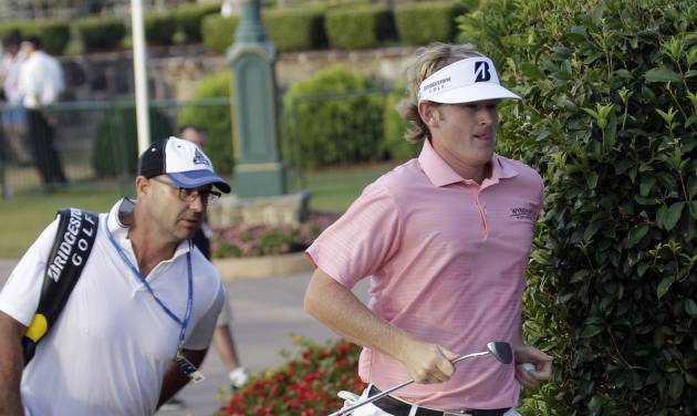 Brandt Snedeker runs to the first tee during the second round of the PGA Championship golf tournament Friday, Aug. 12, 2011, at the Atlanta Athletic Club in Johns Creek, Ga. Snedeker was assessed a two-stroke penalty for being late for his 8:10 a.m. tee time. (AP Photo/David J. Phillip)