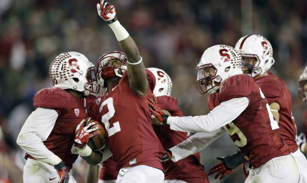 Stanford cornerback Wayne Lyons (2) celebrates after intercepting a pass against Notre Dame during the second half of an NCAA college football game on Saturday, Nov. 30, 2013, in Stanford, Calif. Stanford won 27-20. (AP Photo/Marcio Jose Sanchez)