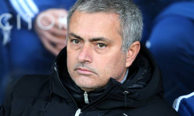 Chelsea's manager Jose Mourinho looks on ahead of their English Premier League soccer match against Hull City at the KC Stadium, Hull, England, Saturday, Jan. 11, 2014. (AP Photo/Scott Heppell)
