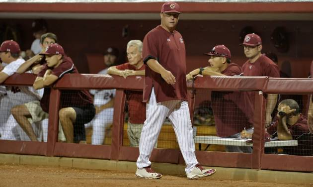 South Carolina head coach Chad Holbrook walks back to the dugout after discussing a call with the umpire in the closing minutes of an NCAA college baseball regional tournament game against Maryland in Columbia, S.C.,  Sunday, June 1, 2014.  Maryland won 10-1. (AP Photo/ Richard Shiro)