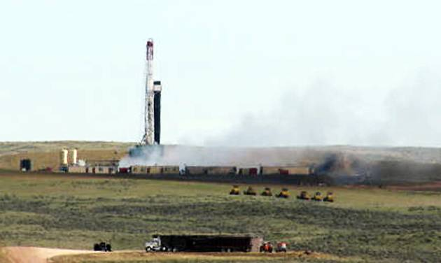 This image provided by the Glenrock Bird shows an out-of-control oil well spewing natural gas a few miles northeast of Douglas in east-central Wyoming on Wednesday April 25, 2012. A blowout occurred at the well Tuesday afternoon. More than 60 people living nearby evacuated from their homes while crews began work to plug the well with drilling mud and avoid an explosion. Nobody was hurt.(AP Photo/Glenrock Bird)