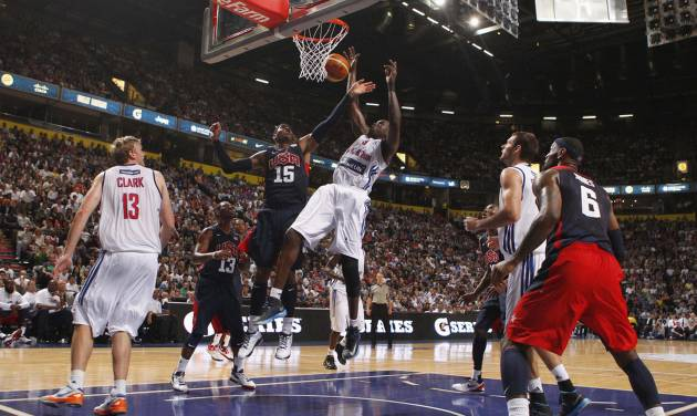 Great Britain's Luol Deng and Carmelo Anthony during an Olympic Warm Up match against the USA at the Manchester Arena, Manchester Thursday July 19, 2012. (AP Photo/ Dave Thompson/PA Wire) UNITED KINGDOM OUT