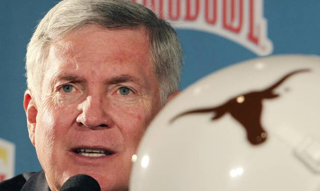 Texas head coach Mack Brown answers a question during a news confercen for the Alamo Bowl NCAA college football game at Sonterra Country Club on Thursday, Dec. 6, 2012 in San Antonio, Texas. The Longhorns play Oregon State on Saturday, Dec. 29.  (AP Photo/San Antonio Express-News, Kin Man Hui) RUMBO DE SAN ANTONIO OUT; NO SALES