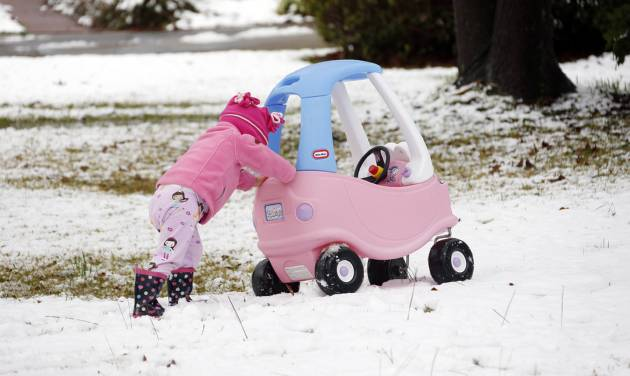 Molly Cleland, two and a half,  pushes her car through the snow in Jackson, Miss., Thursday,  Jan. 17, 2013.  A winter storm system left 2 to 4 inches of snow in parts of central Mississippi before heading east toward Alabama, the National Weather Service said. (AP Photo/Rogelio V. Solis)