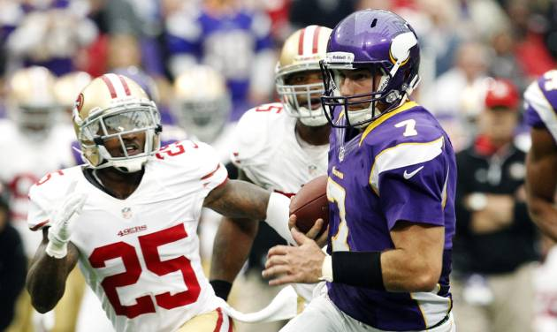 Minnesota Vikings quarterback Christian Ponder (7) runs from San Francisco 49ers cornerback Tarell Brown (25) during a touchdown run in the first half of an NFL football game, Sunday, Sept. 23, 2012, in Minneapolis. (AP Photo/Genevieve Ross)