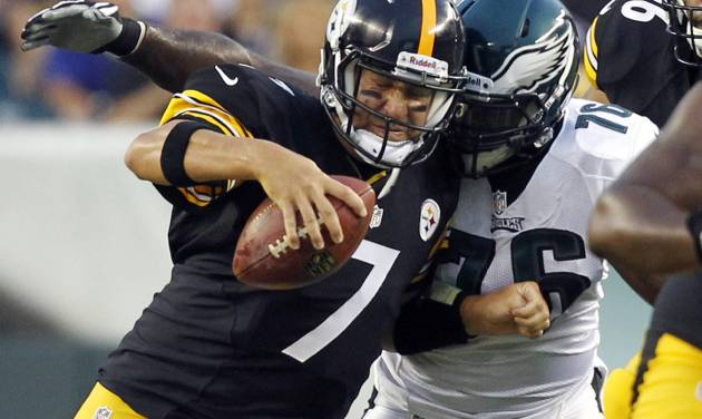 FILE - In this Aug. 9, 2012, file phot, Pittsburgh Steelers quaterback Ben Roethlisberger (7) is sacked by Philadelphia Eagles tackle Thomas Welch (76) during the first half of an NFL preseason football game in Philadelphia. Roethlisberger recalls getting knocked around pretty hard and not finishing the game the last time he faced the Eagles, who haven't hit quarterbacks quite as often as they're used to so far this season. (AP Photo/Mel Evans, File)