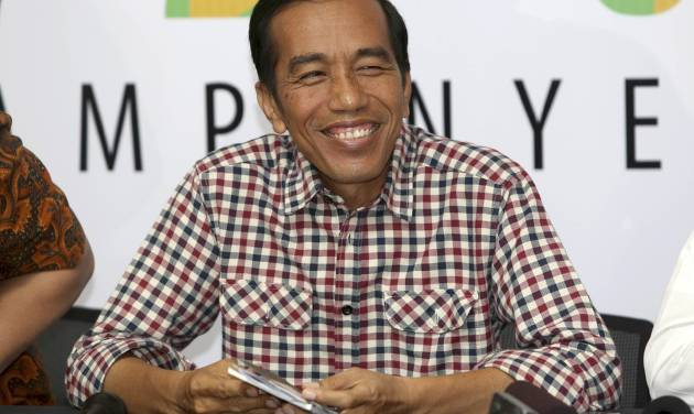 """Indonesian presidential candidate Joko Widodo, popularly known as """"Jokowi"""" smiles during a press conference in Jakarta, Indonesia, Thursday, July 10, 2014. Jakarta Governor Joko """"Jokowi"""" Widodo and former army general Prabowo Subianto are both claiming victory in Indonesia's presidential election based on unofficial """"quick counts,"""" raising the specter of prolonged political instability in Southeast Asia's largest economy. (AP Photo/Tatan Syuflana)"""