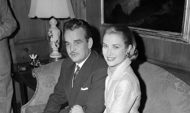 In this Jan. 5, 1956 file photo, actress Grace Kelly and Prince Rainier III of Monaco, sit arm-in-arm as they meet the press in Philadelphia, Pa, USA. Grace Kelly can bring to mind several things: an Oscar-winning Hollywood actress, a mother, a princess and a Nicole Kidman movie premiering at the Cannes Film Festival on Wednesday, May 14, 2014. (AP Photo)