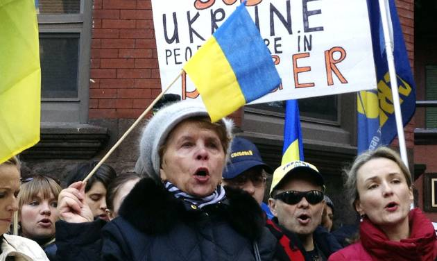 CORRECTS TO UKRAINIAN CONSULATE INSTEAD OF EMBASSY - Maria Semkiv, 66, gathers with others outside the Ukrainian Consulate in Chicago, Wednesday, Feb. 19, 2014, to protest the deadly violence in the Ukraine capital of Kiev and call for a stronger response by the United States and the European Union. Clashes on Tuesday left 25 people dead in the worst violence in nearly three months of anti-government protests in Ukraine's capital. Protests began after the president backed away from a deal to join the European Union. (AP Photo/Tammy Webber)