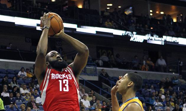 Houston Rockets guard James Harden (13) shoots over New Orleans Hornets forward Anthony Davis in the first half of an NBA basketball game in New Orleans, Friday, Jan. 25, 2013. (AP Photo/Gerald Herbert)