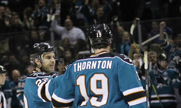 San Jose Sharks defenseman Dan Boyle (22) is congratulated by Joe Thornton (19) after scoring a goal against the Nashville Predators during the first period of an NHL hockey game in San Jose, Calif., Saturday, March 2, 2013. (AP Photo/Tony Avelar)