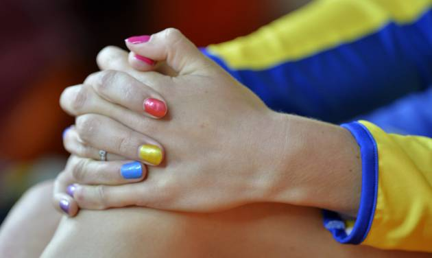Sweden's Moa Hjelmer, her nails painted in a variety of colors, watches the women's 200-meter final at the World Athletics Championships in the Luzhniki stadium in Moscow, Russia, Friday, Aug. 16, 2013. (AP Photo/Martin Meissner)