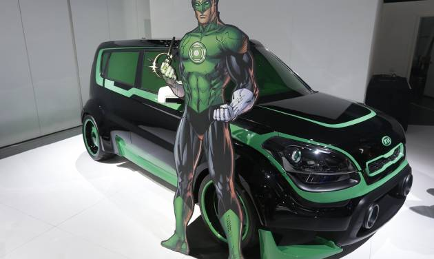 "The Green Lantern-wrapped Kia Soul is on display at the North American International Auto Show in Detroit, Tuesday, Jan. 15, 2013. The Batman-decorated Kia Optima and the Green Lantern-wrapped Kia Soul are at the South Korean automaker's exhibit to promote an effort to fight hunger in Africa. Features include the Green Lantern's symbol on the Soul's wheels. The vehicles were created as part of a partnership involving DC Entertainment. The ""We Can Be Heroes"" effort is promoted in part by the use of Justice League characters. (AP Photo/Carlos Osorio)"