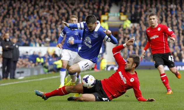 Everton's Kevin Mirallas , left, and Cardiff City's Juan Cala battle for the ball during their English Premier League soccer match at Goodison Park, Liverpool, England, Saturday, March 15, 2014. (AP Photo/Peter Byrne, PA Wire)    UNITED KINGDOM OUT   -  NO SALES   -   NO ARCHIVES