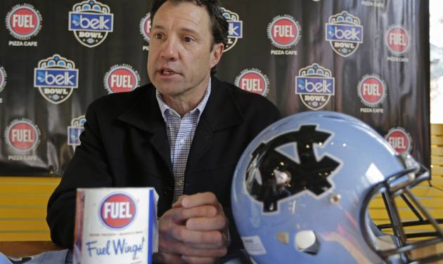 North Carolina coach Larry Fedora answer a question during the media day event for the Belk Bowl NCAA college football game in Charlotte, N.C., Friday, Dec. 27, 2013. North Carolina faces Cincinnati in the Belk Bowl on Saturday. (AP Photo/Chuck Burton)