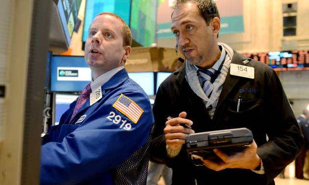 FILE -In this Thursday, Nov. 8, 2012, file photo, Robert Nelson II of Barclays, left, and Fady Tanios of Raven Securities work on the floor of the New York Stock Exchange, in New York. (AP Photo/Henny Ray Abrams)