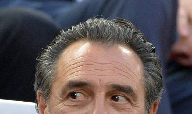 Coach of the Italian national team Cesare Prandelli follows the Europa League soccer final between Sevilla and Benfica, at the Turin Juventus stadium in Turin, Italy, Wednesday, May 14, 2014. (AP Photo/Massimo Pinca)