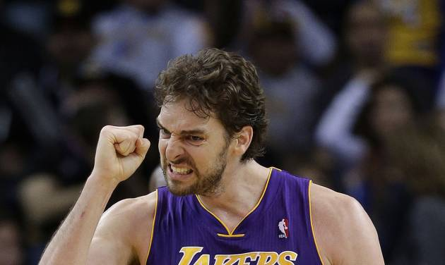 Los Angeles Lakers' Pau Gasol (16) celebrates after scoring against the Golden State Warriors during the second half of an NBA basketball game in Oakland, Calif., Saturday, Dec. 22, 2012. Los Angeles won in overtime 118-115. (AP Photo/Marcio Jose Sanchez)