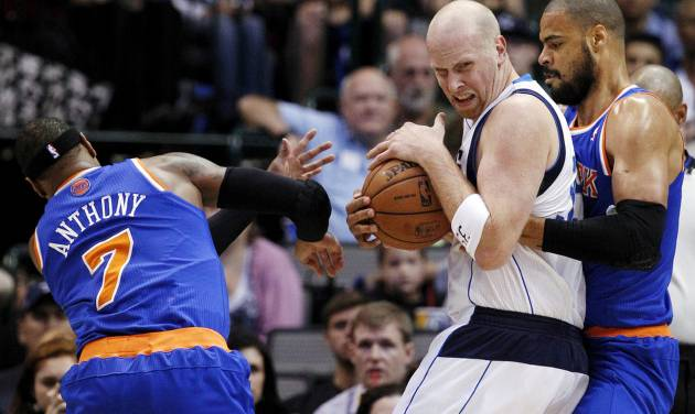 New York Knicks' Carmelo Anthony (7) and Tyson Chandler, right, defend against Dallas Mavericks' Chris Kaman in the first half of an NBA basketball game, Wednesday, Nov. 21, 2012, in Dallas. (AP Photo/Tony Gutierrez)