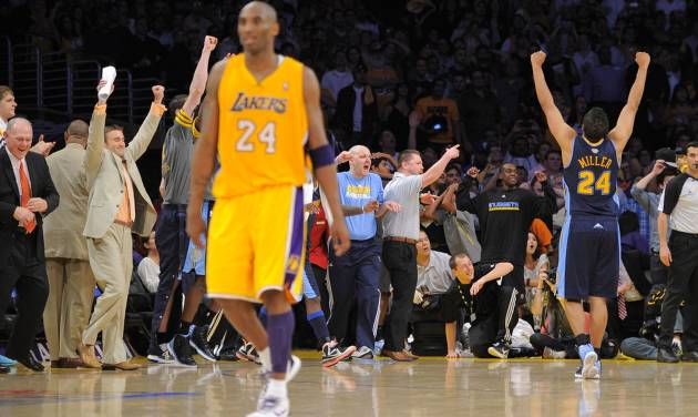 Denver Nuggets guard Andre Miller, right, celebrates as Los Angeles Lakers guard Kobe Bryant walks off the court after time ran out in Game 5 of an NBA first-round playoff basketball game, Tuesday, May 8, 2012, in Los Angeles. The Nuggets won 102-99. (AP Photo/Mark J. Terrill)