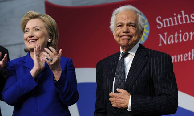 "Designer Ralph Lauren is applauded by former Secretary of State Hillary Clinton after Lauren receiving the James Smithson Bicentennial Medal ""for his embodiment of the American experience through the medium of fashion, design and philanthropy"" Tuesday, June 17, 2014, during a ceremony at the Smithsonian's National Museum of American History in Washington. Lauren was honored his efforts to fund the conservation of the flag that inspired the national anthem. (AP Photo/Susan Walsh)"