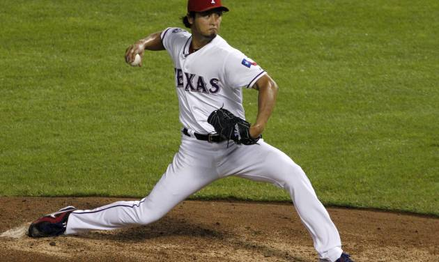 Texas Rangers' Yu Darvish of Japan delivers to the Seattle Mariners in the fifth inning of a baseball game Friday, Sept. 14, 2012, in Arlington, Texas. (AP Photo/Tony Gutierrez)
