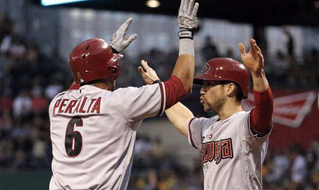 Arizona Diamondbacks' David Peralta (6) celebrates with teammate Ender Inciarte who was on base for his two-run home run off Pittsburgh Pirates starting pitcher Vance Worley during the sixth inning of a baseball game in Pittsburgh Thursday, July 3, 2014. (AP Photo/Gene J. Puskar)